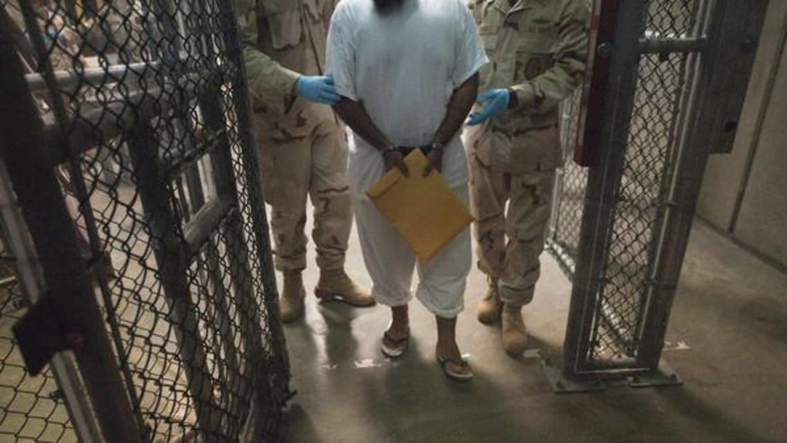 This March 30, 2010 file photo shows US military guards as they move a detainee inside Camp VI at Guantanamo Bay, Cuba. (File photo AFP)