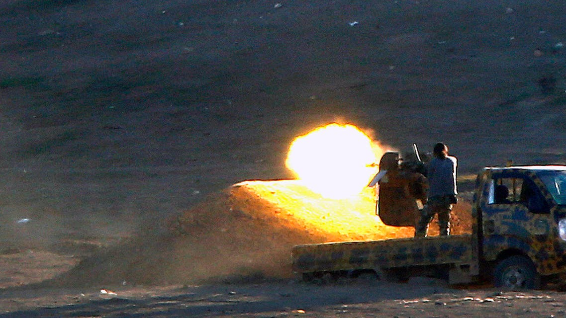 Free Syrian Army fighters fire on ISIS west of Kobani Reuters