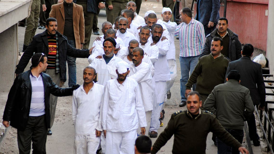 Some of 163 defendants, 75 of whom are in custody, facing charges including murder, incitement, robbery and kidnapping over a bloody tribal feud that killed 26 people are taken to a courtroom in Assiut, Egypt, Saturday, Jan. 17, 2015. (AP)