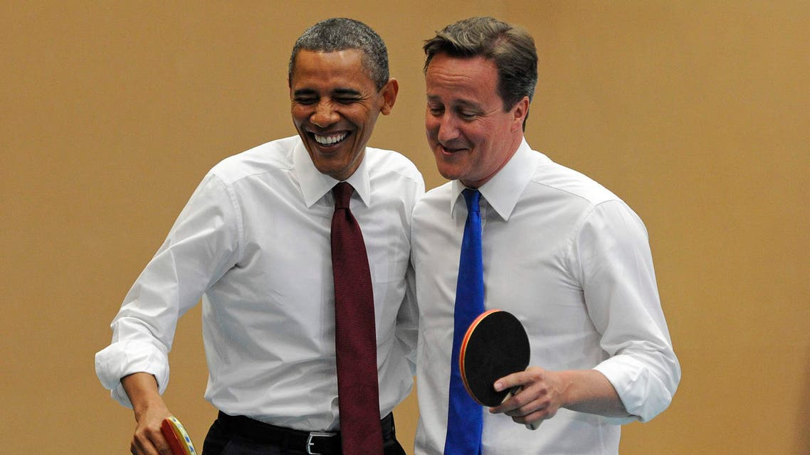 U.S. President Barack Obama, left, and Britain's Prime Minister David Cameron laugh as they play table tennis at Globe Academy, in south London Tuesday May 24, 2011. AP