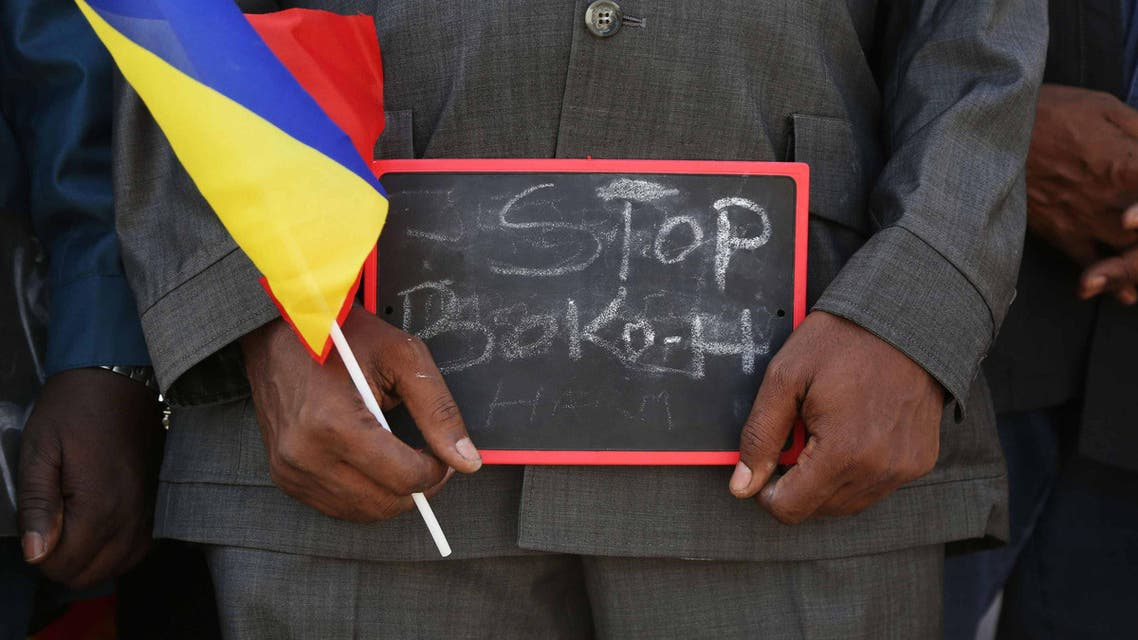 A man holds a sign that reads Stop Boko Haram at a rally to support Chadian troops heading to Cameroon to fight Boko Haram, in Ndjamena January 17, 2015. (Reuters)