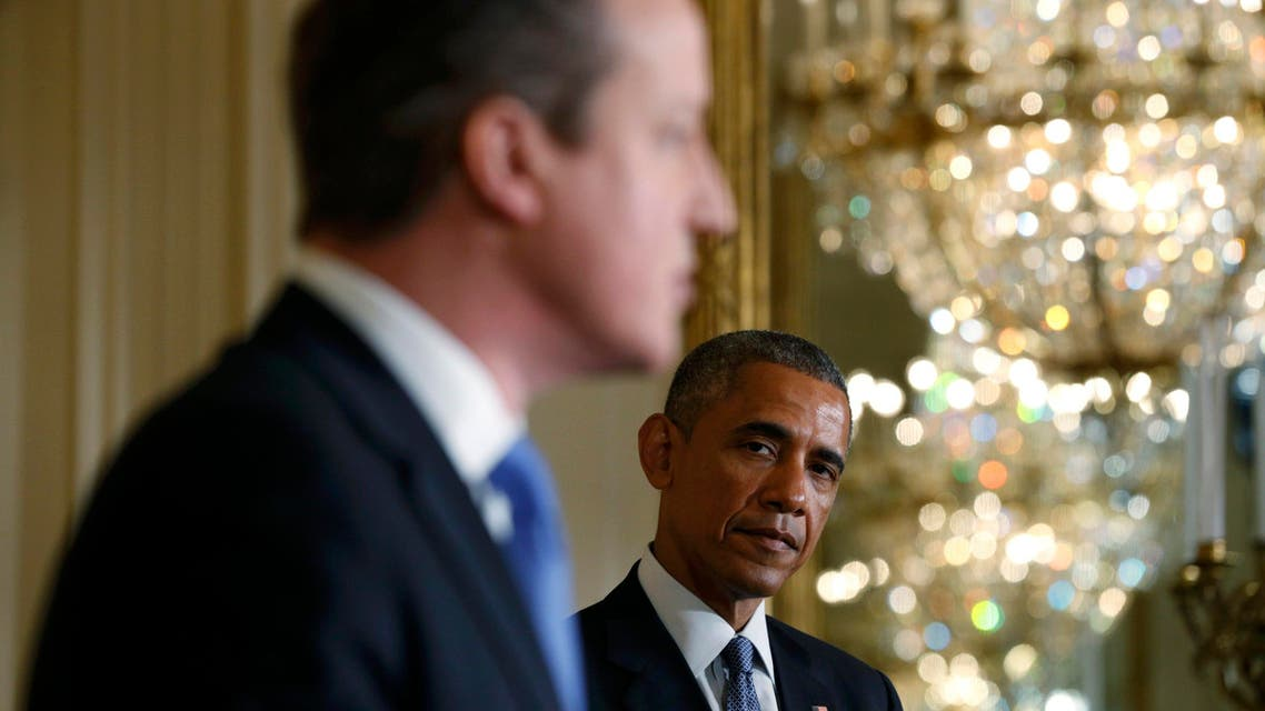 U.S. President Barack Obama (R) listens to British Prime Minister David Cameron during a joint news conference following their meeting at the White House in Washington January 16, 2015. (Reuters)