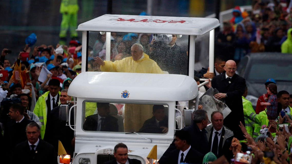 Pope Francis waves from the popemobile after leading a Mass at Rizal Park in Manila January 18, 2015. (Reuters)