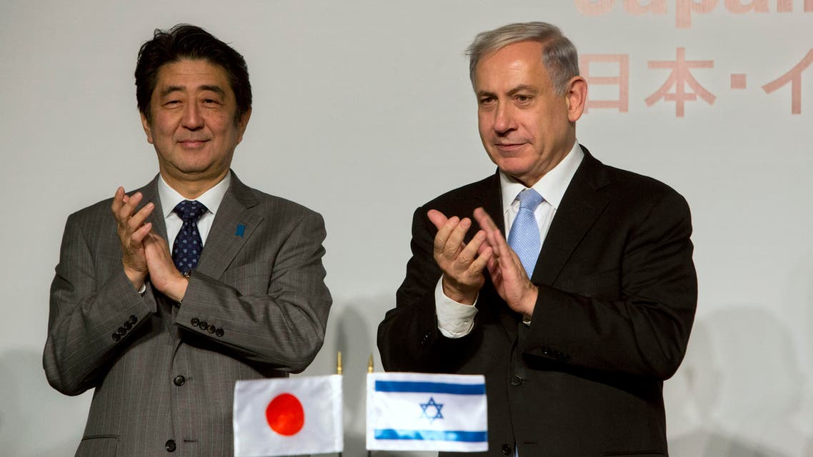 Japan's Prime Minister Shinzo Abe, left, stands with Israeli Prime Minister Benjamin Netanyahu during a conference in Jerusalem, Sunday, Jan. 18, 2015. (Reuters)