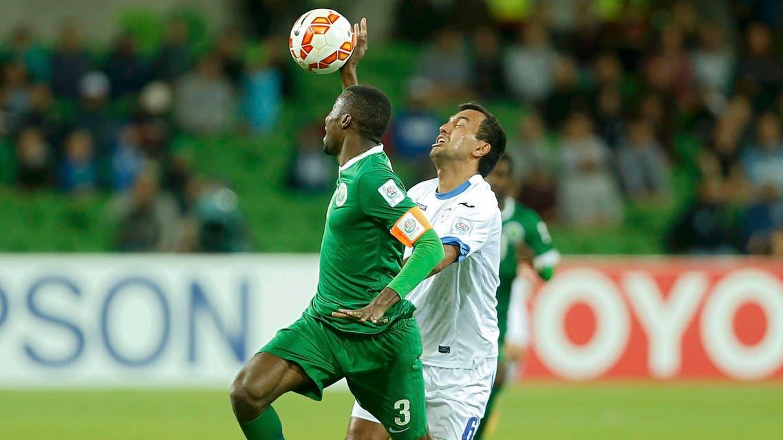 Uzbekistan's Bakhodir Nasimov makes a foul against Saudi Arabia's Osama Hawsawi (L) during their Asian Cup Group B soccer match at the Rectangular stadium in Melbourne January 18, 2015. (Reuters)