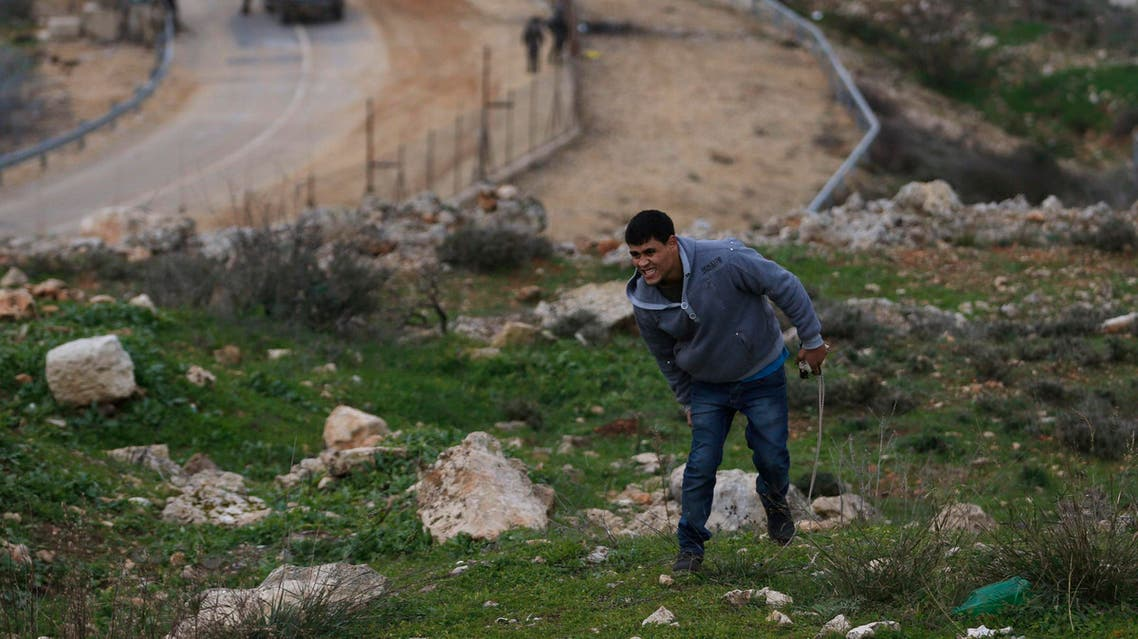 A wounded Palestinian protester reacts after being shot during clashes with Israeli troops near Israel's Ofer Prison, near the West Bank city of Ramallah January 2, 2015. (Reuters)