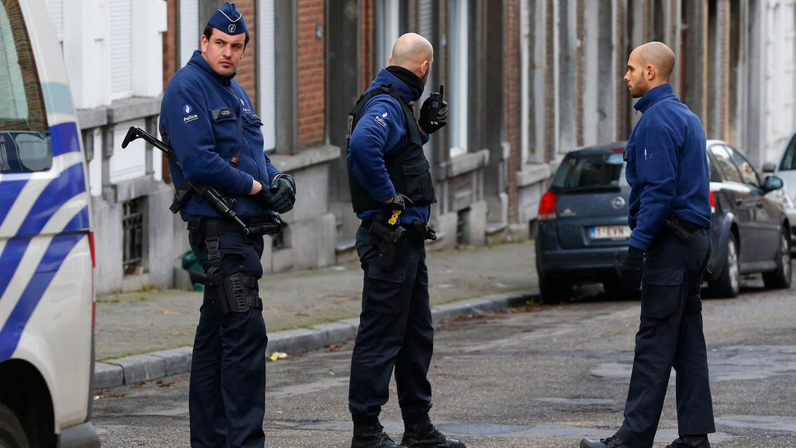 Police officers stands on a roadblock in Verviers January 16, 2015. (Reuters)