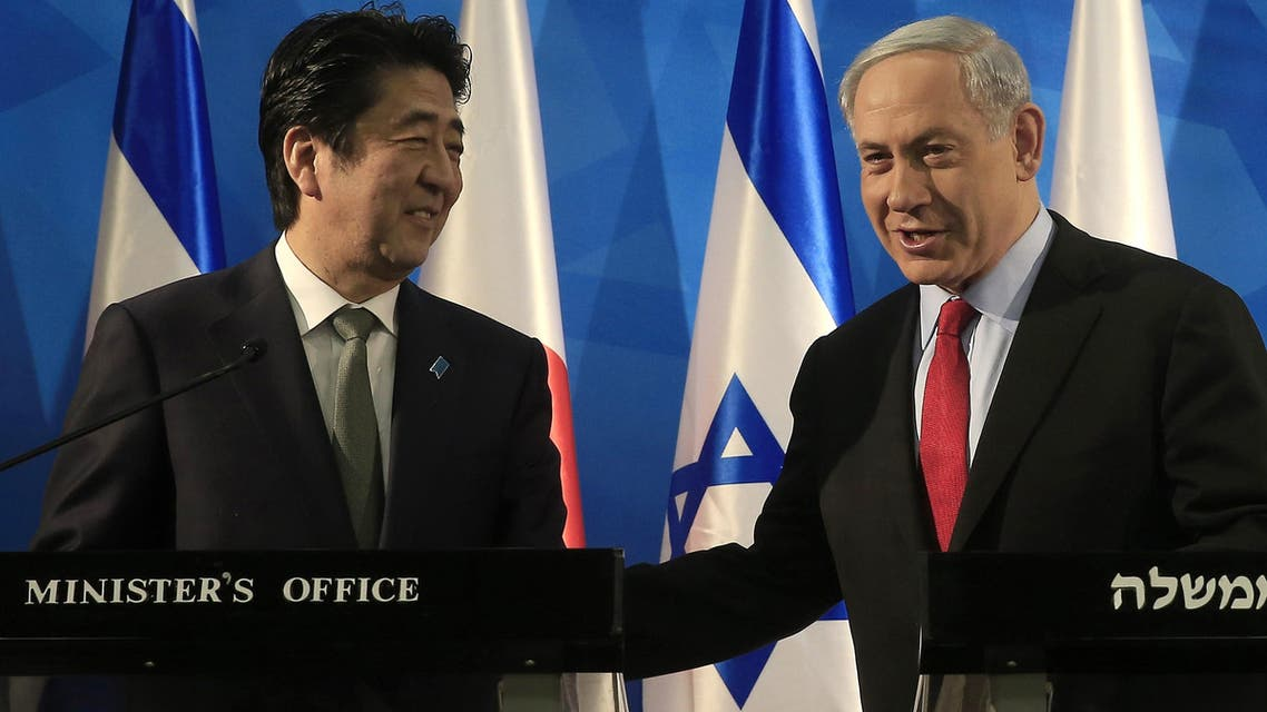 Japanese Prime Minister Shinzo Abe and Israeli Prime Minister Benjamin Netanyahu (R) give a joint press conference at the Prime Minister's office in Jerusalem. AFP