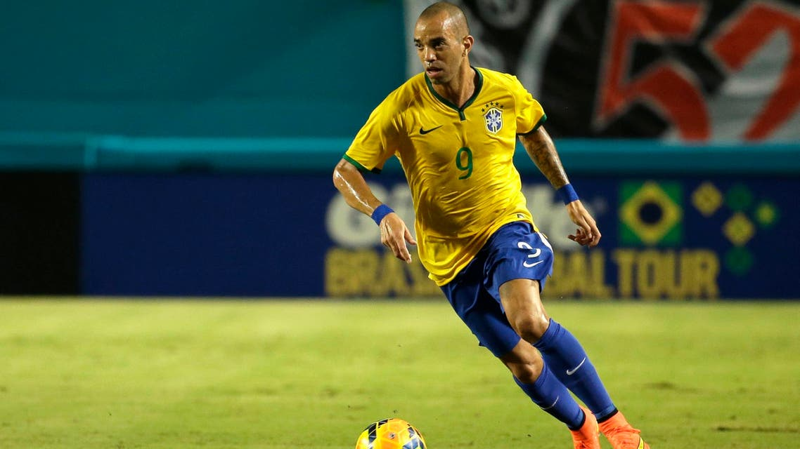 Brazil's Diego Tardelli (9) goes for the ball in the first half of an international friendly soccer match against Colombia, Friday, Sept. 5, 2014, in Miami Gardens, Fla. (AP Photo)