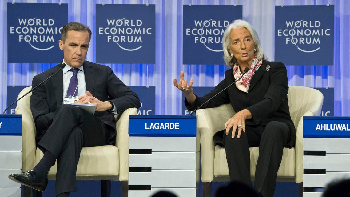 Head of the International Monetary Fund Christine Lagarde, right, gestures as she speaks while Governor of the Bank of England Mark J. Carney, sits next to her during a session at the World Economic Forum in Davos, Switzerland, Saturday, Jan. 25, 2014. (AP Photo)