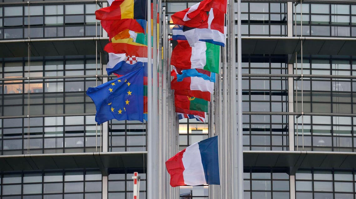 The French and European flags fly at half-mast among flags of the other member states of the European Union in front of the European Parliament in Strasbourg, January 8, 2015. (Reuters)