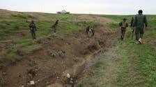 Syrian Kurds battling ISIS capture strategic Kobane hill top