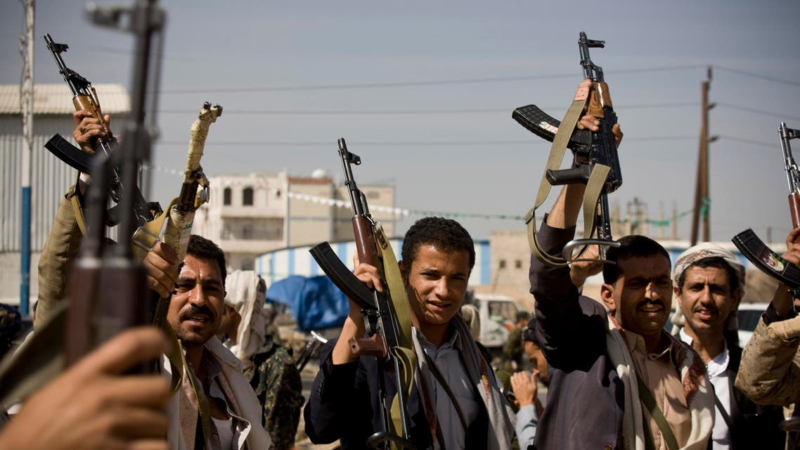 Houthi Shiite Yemeni hold their weapons during clashes in near the presidential palace in Sanaa, Yemen, Monday, Jan. 19, 2015.