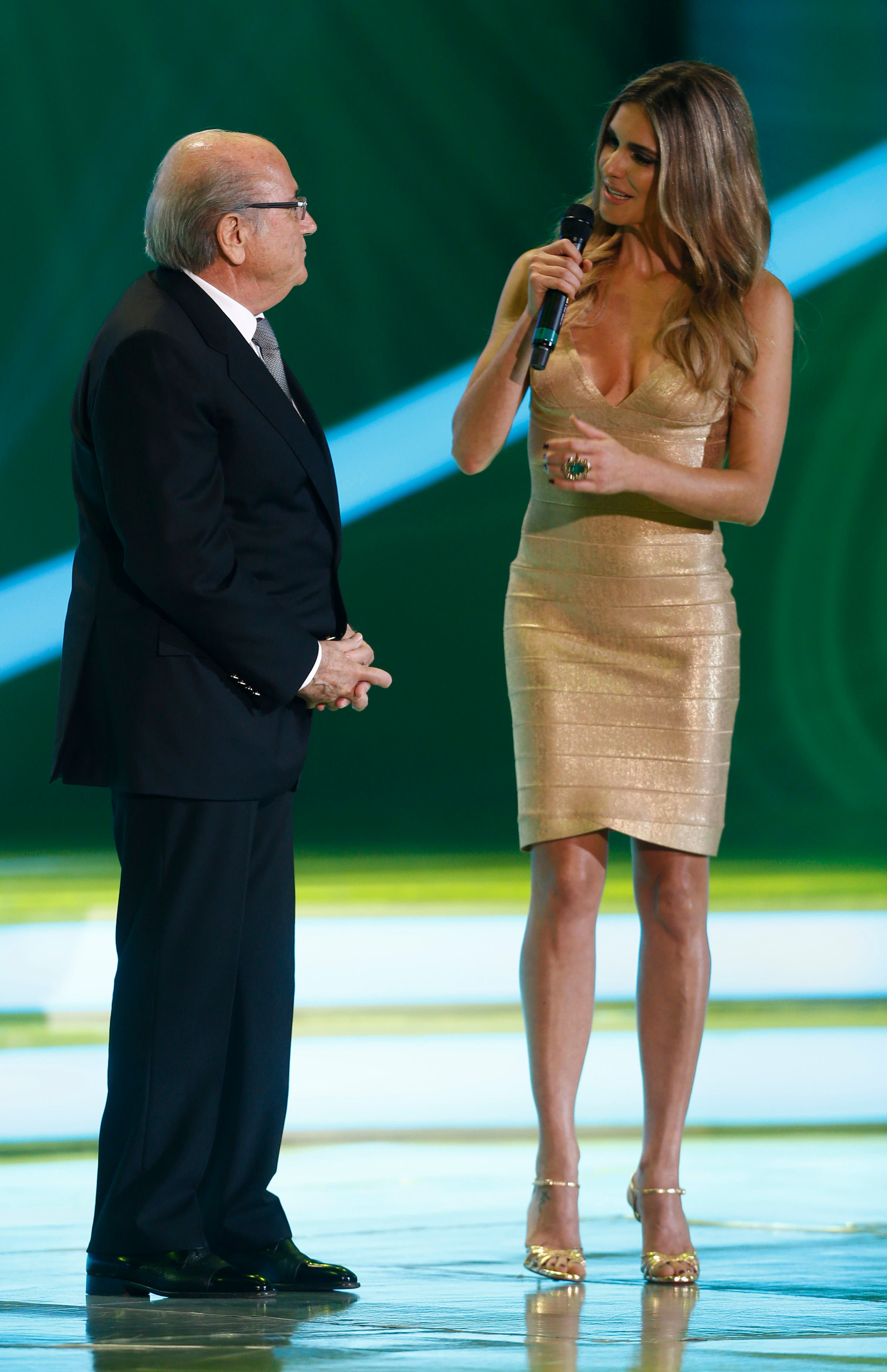 FIFA President Joseph Blatter is interviewed by Brazilian actress Fernanda Lima, right, during the draw ceremony for the 2014 soccer World Cup, Brazil, 2013. (AP)