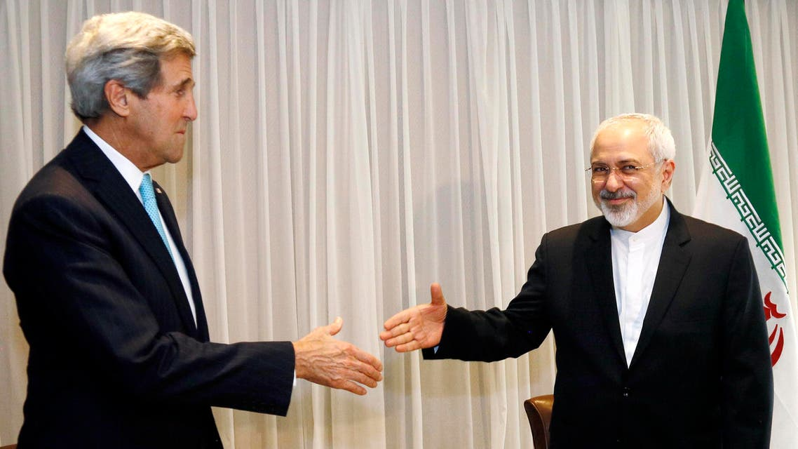 U.S. Secretary of State John Kerry shakes hands with Iranian Foreign Minister Mohammad Javad Zarif before a meeting in Geneva Jan. 14, 2015. (Reuters)