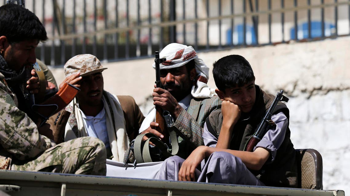 Houthi fighters ride in a truck outside a Presidential Guards barracks they took over on a mountain overlooking the Presidential Palace in Sanaa Jan. 20, 2015. (Reuters)