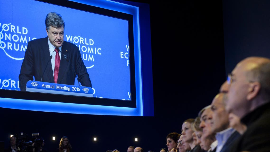Ukrainian president Petro Poroshenko is seen on a giant screen during a session of the World Economic Forum (WEF) annual meeting on January 21, 2014 in Davos.