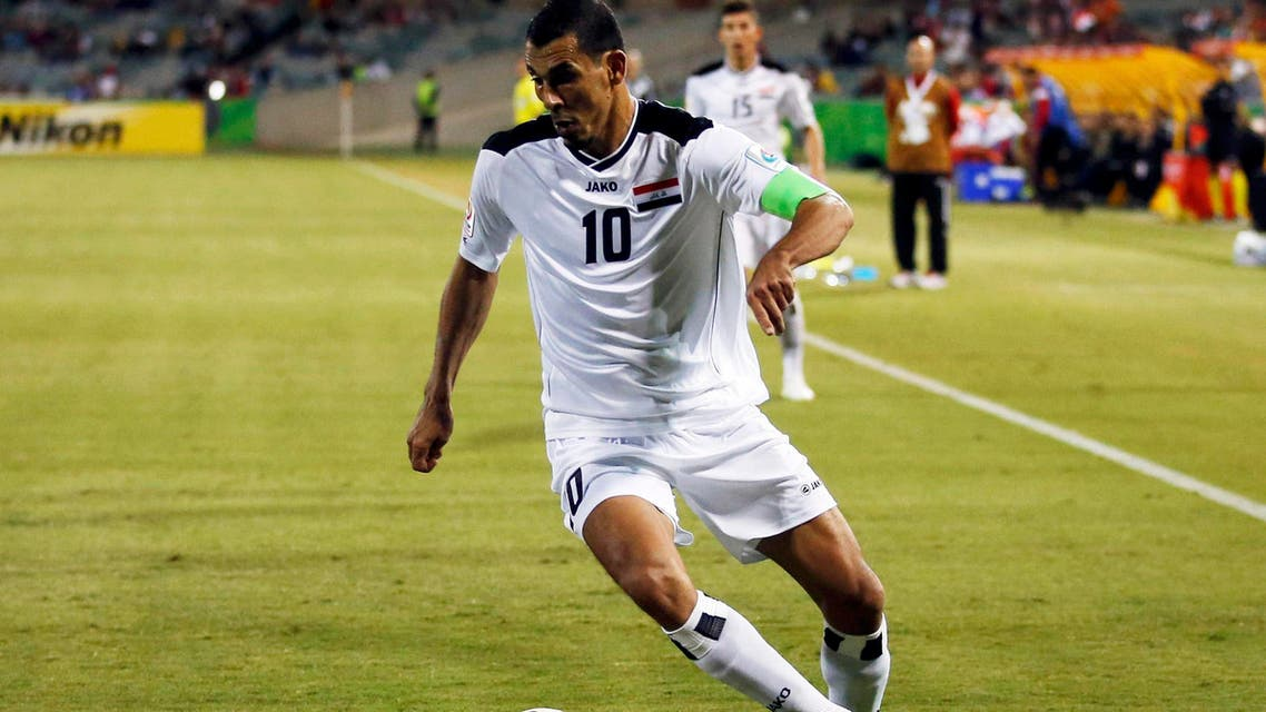 Iraq's Younus Mahmood runs with the ball during their Asian Cup Group D soccer match against Palestine at the Canberra stadium in Canberra Jan. 20, 2015. (Reuters)