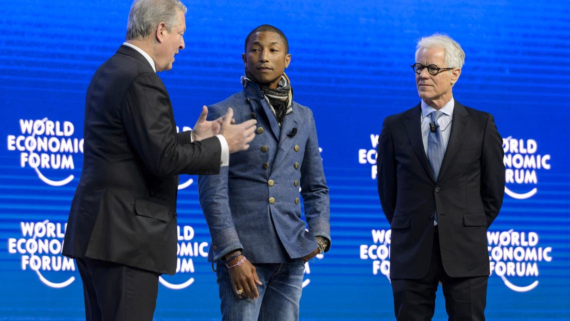 US singer Pharrell Williams (C) and Live Earth founder Kevin Wall (R) listen to Former US Vice President Al Gore during a session of the World Economic Forum (WEF) annual meeting on January 21, 2014