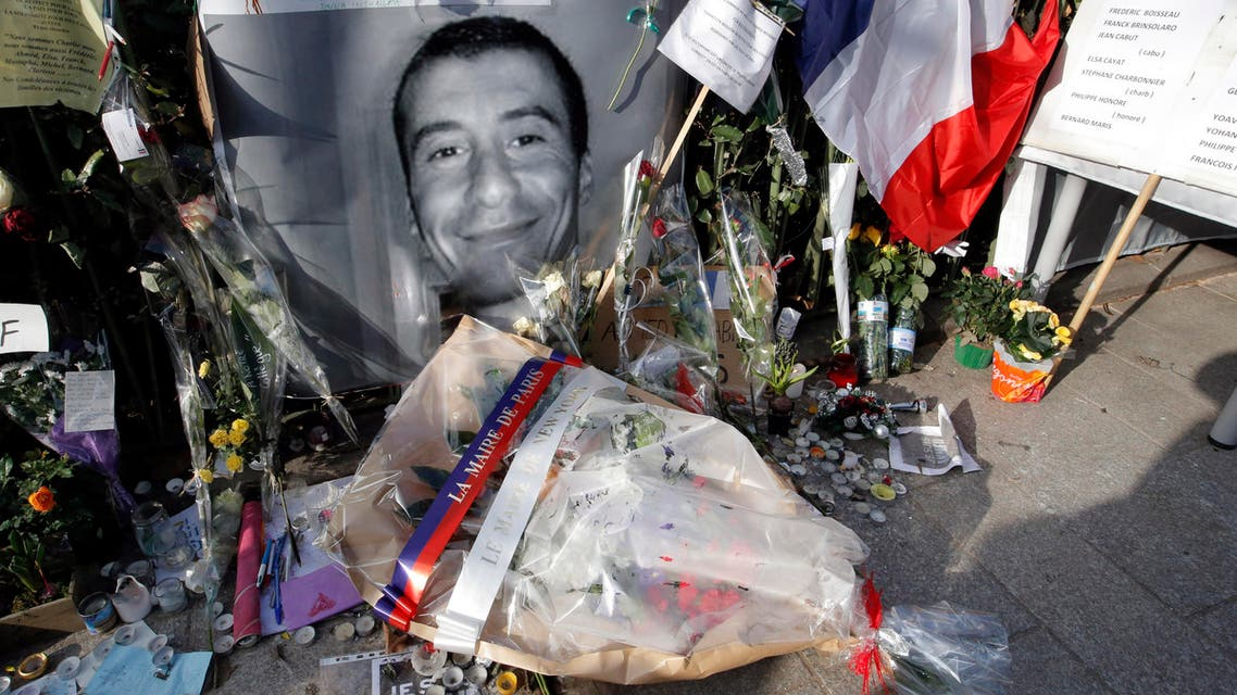 The wreath of flowers laid at the spot where police officer Ahmed Merabet, featured in photo, was killed in Paris. (AP)