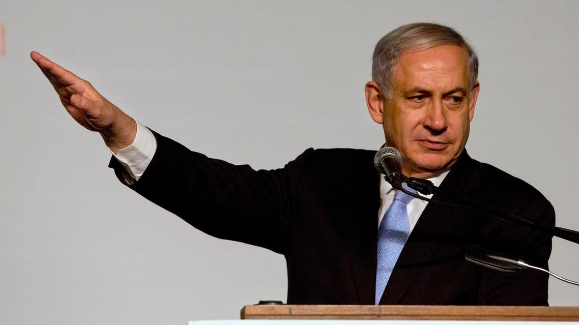 Israeli Prime Minister Benjamin Netanyahu gestures as he speak during a conference with Japan's Prime Minister Shinzo Abe in Jerusalem, Sunday, Jan. 18, 2015. Abe is on his six-day visit to the Middle East. (AP Photo/Sebastian Scheiner)