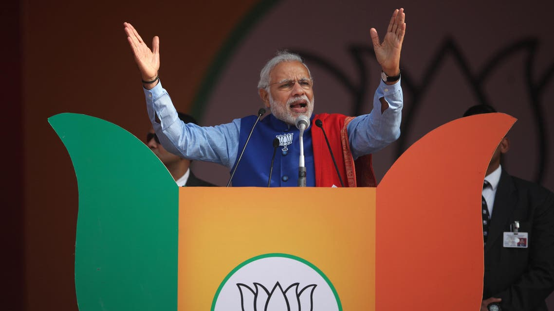 Indian Prime Minister Narendra Modi addresses a public rally New Delhi, India, Saturday, Jan. 10, 2015. The rally is meant to kickstart his Bharatiya Janata Party's campaign for the upcoming Delhi polls, expected to be held in February. (AP Photo/Altaf Qadri)