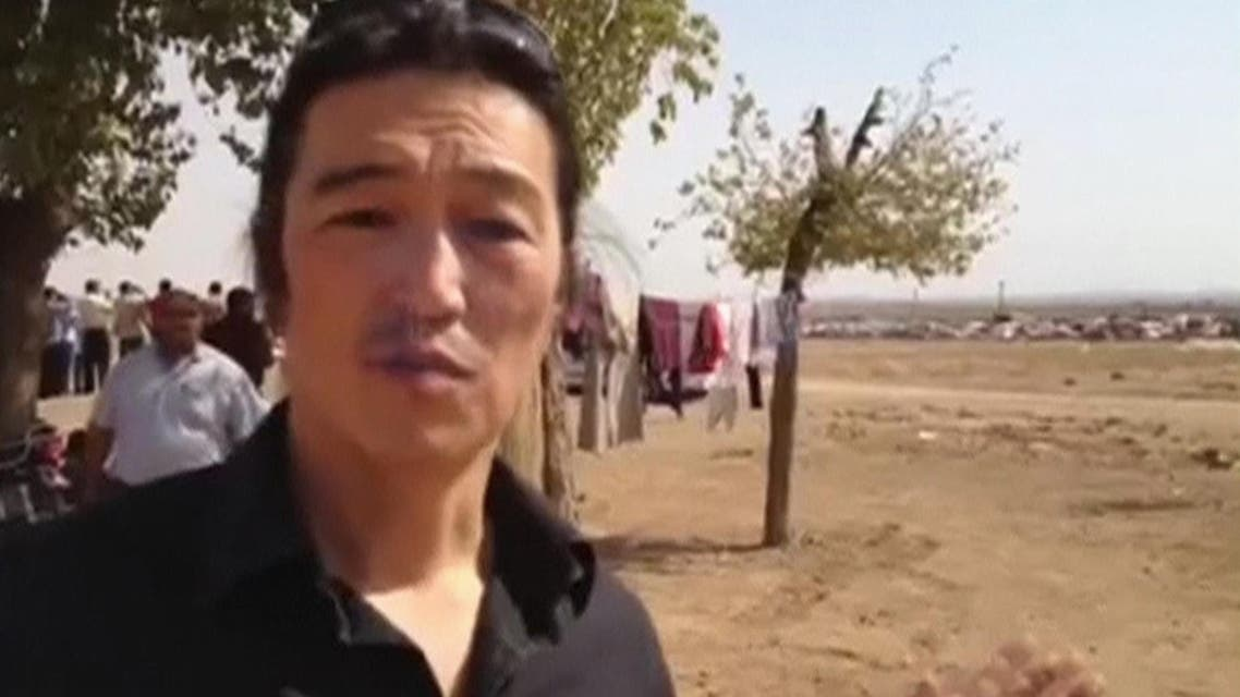 Japanese journalist Kenji Goto reports in Kobani in October 2014 in this still image taken from the website www.reportr.co. (AP)