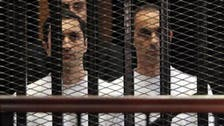 Cairo court clears Mubarak brothers for release