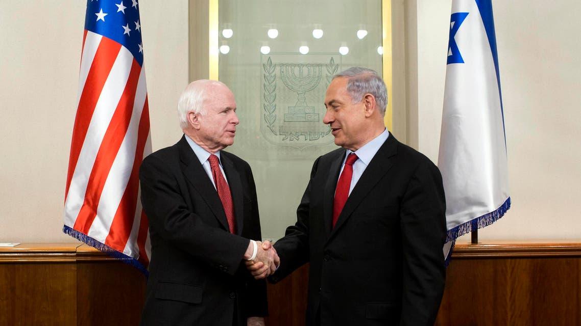 Israel's Prime Minister Benjamin Netanyahu (R) shakes hands with U.S. Senator John McCain (R-AZ) during their meeting in Jerusalem Jan. 19, 2015.  (Reuters)