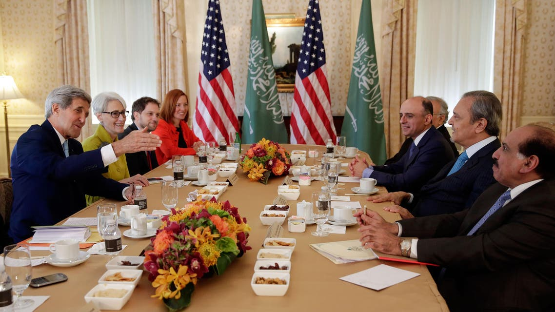 audi Foreign Minister Prince Saud Al-Faisal, second from right, and U.S. Secretary of State John Kerry, left, and their representatives, pause for photos at the end of their meeting, at the Waldorf Astoria Hotel, in New York, Monday, Sept. 22, 2014. (Reuters)
