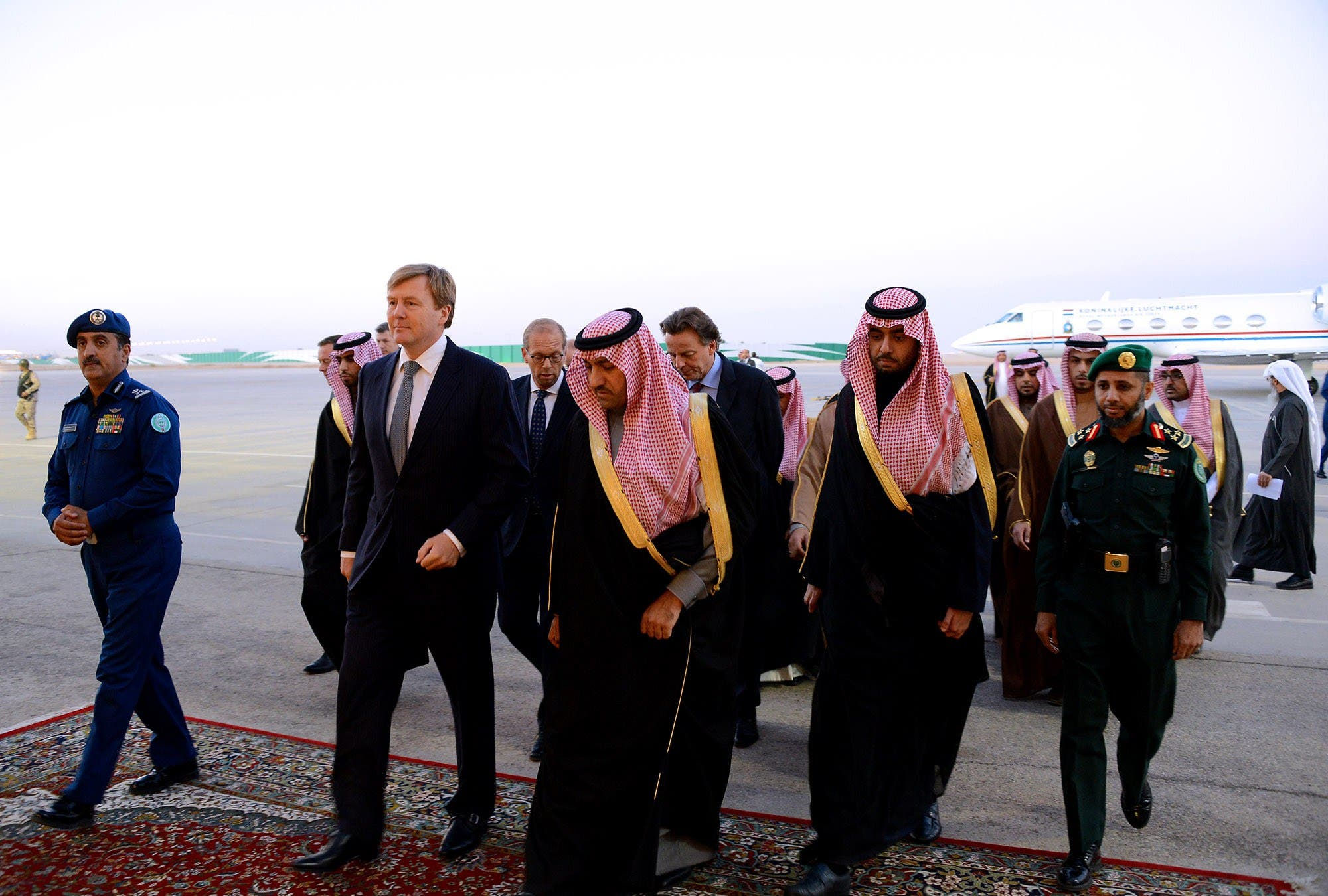 Saudi Prince and Emir of Riyadh Turki bin Abdullah bin Abdelaziz (C) welcoming Dutch King Willem-Alexander (2nd--L) upon his arrival in Riyadh. (AFP)