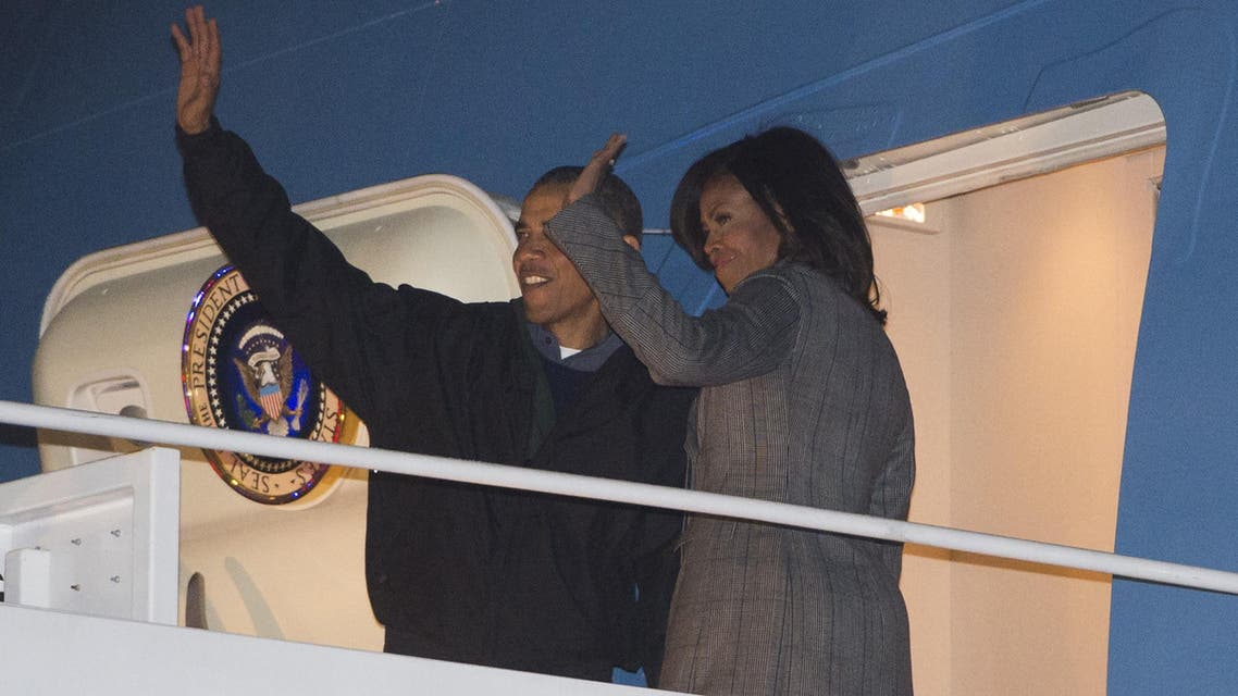 U.S. President Barack Obama and First Lady Michelle Obama board Air Force One prior to departing from Andrews Air Force Base in Maryland, on Jan. 24, 2015. (AFP)