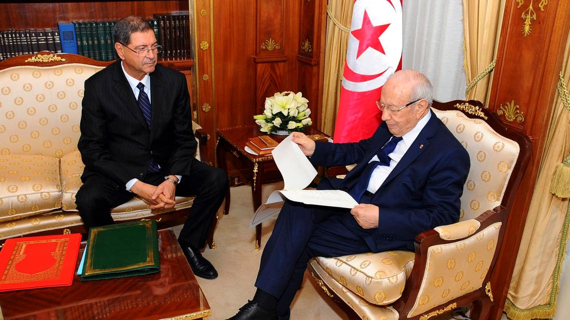 Tunisia's nominated prime minister Habib Essid (L) gives the list of the new government to President Beji Caid Essebsi in Tunis January 23, 2015. (Reuters)