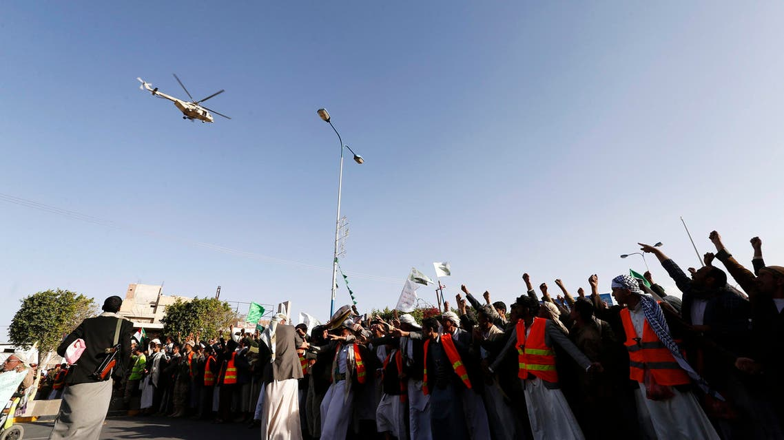 A military helicopter hovers above as followers of the Houthi movement as they demonstrate to show support to the movement in Sanaa January 23, 2015. (Reuters)