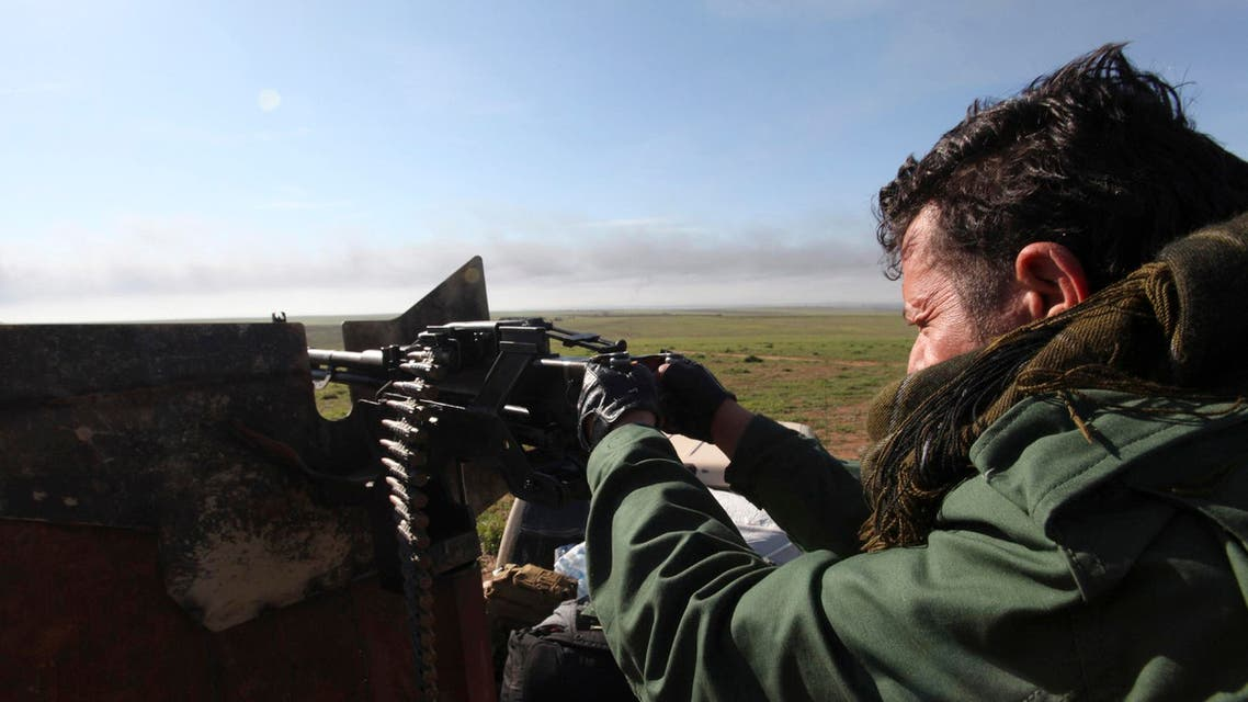 Kurdish Peshmerga fighters keep watch during the battle with Islamic State militants on the outskirts of Mosul January 21, 2015. Reuters