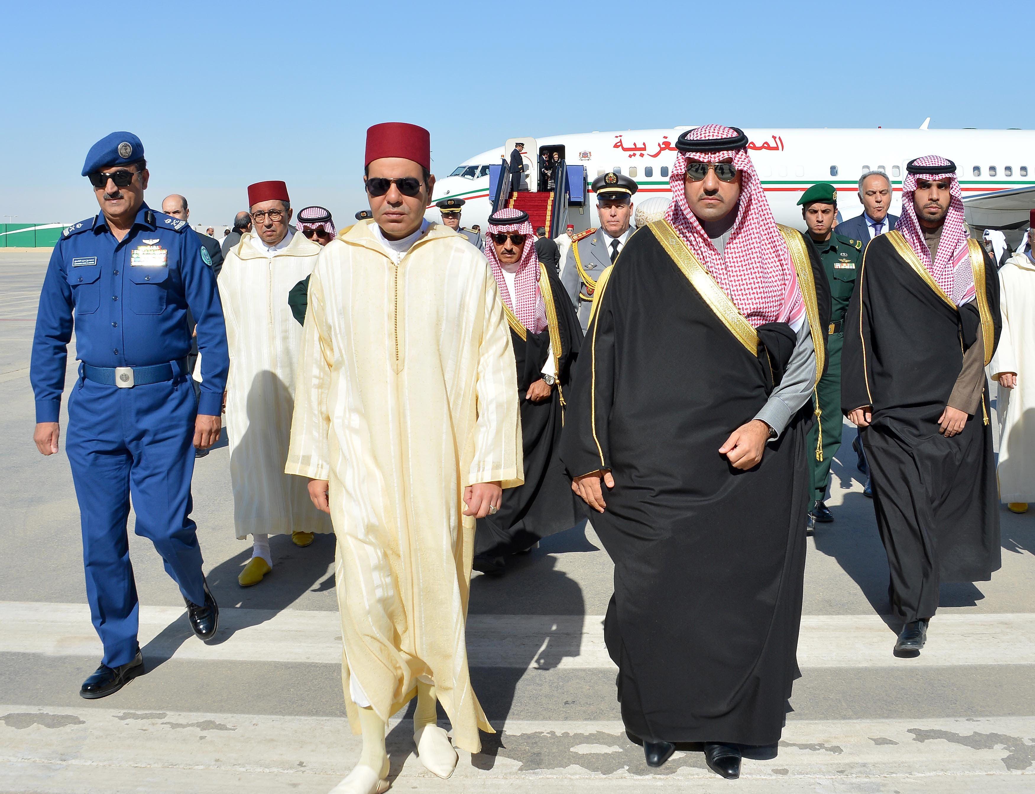 Saudi Prince and Emir of Riyadh Turki bin Abdullah bin Abdelaziz (C-R) welcoming Prince Rachid of Morocco. (AFP)