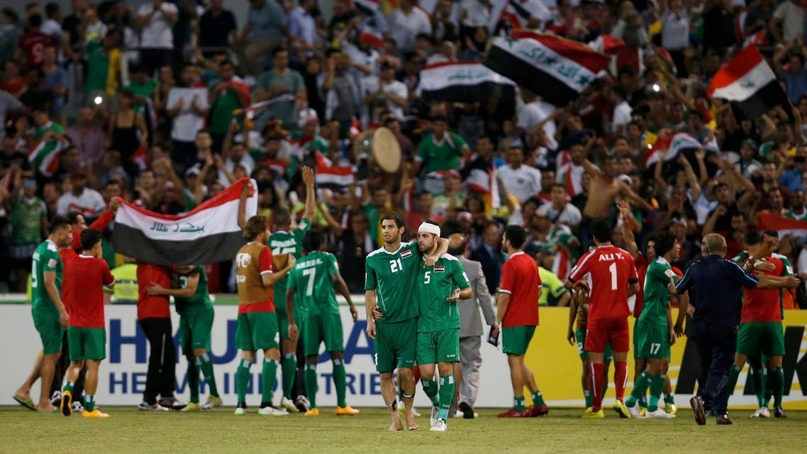 Iraq's Saad Abdulameer Al- Dobjahawe (L) and Yaser Safa Kasim (R) celebrate their win after the Asian Cup quarter-final soccer match between Iran and Iraq at the Canberra stadium in Canberra January 23, 2015. REUTERS