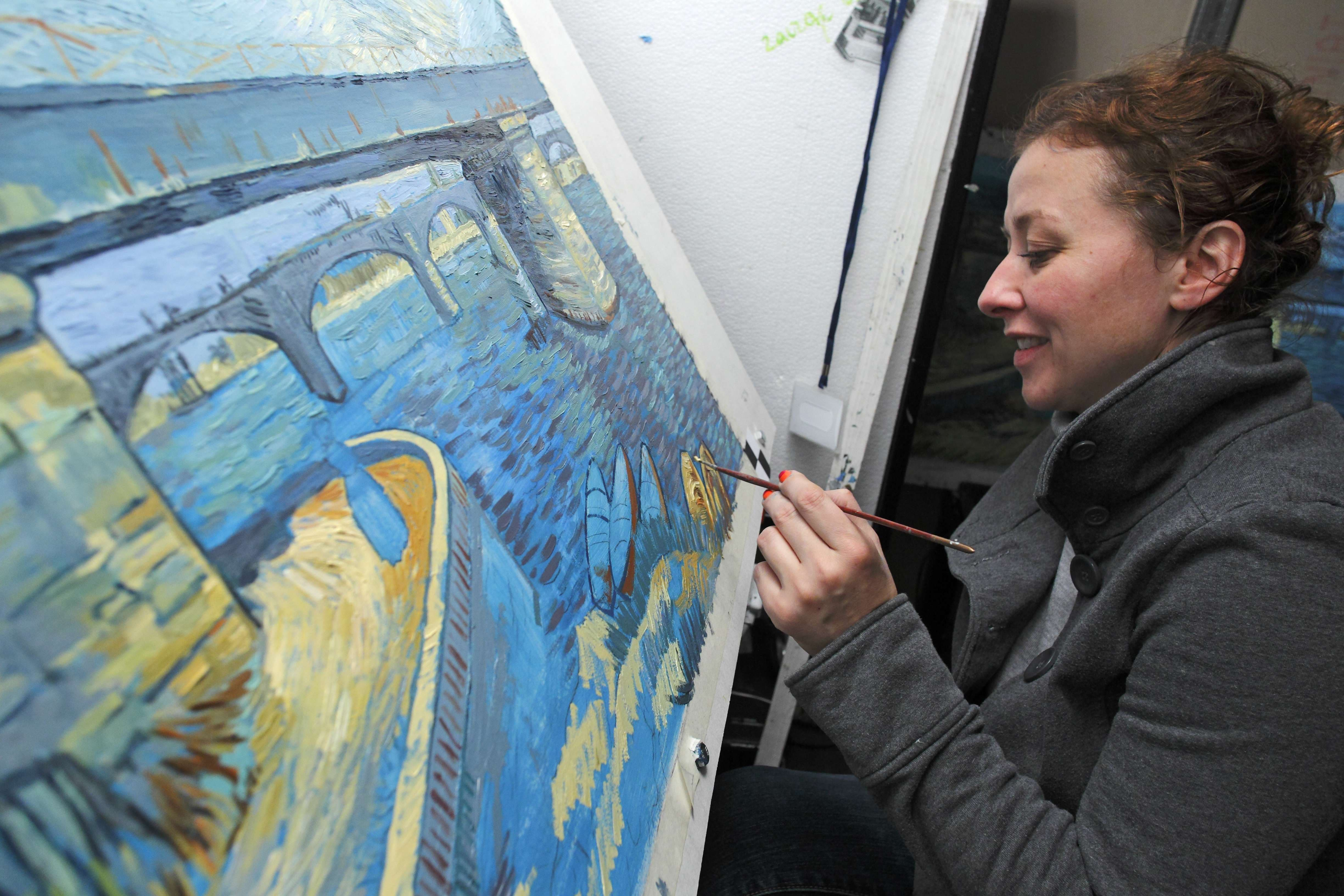 Danuta Roman recreates a Vincent van Gogh painting at a film studio in the northern Polish city of Gdansk on December 5, 2014. (AFP)