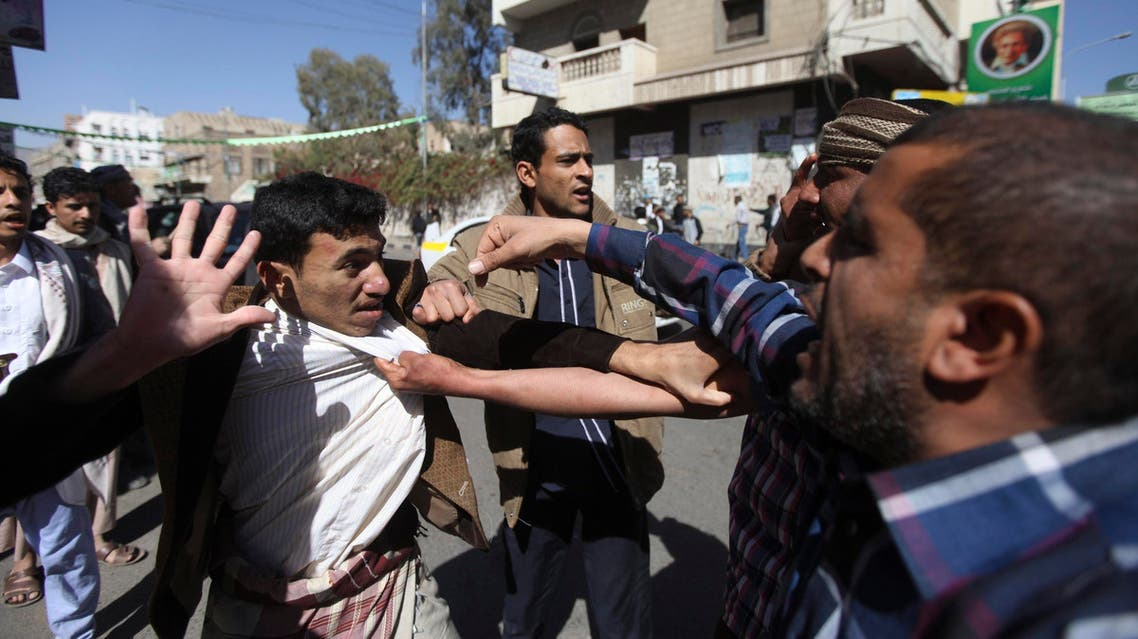Supporters of the Houthi movement clash with anti-Houthi protesters during a rally in Sanaa January 24, 2015. (Reuters)