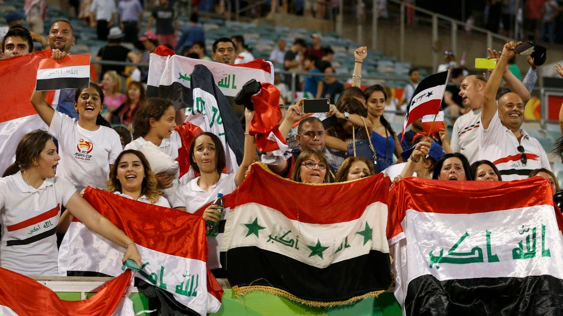 Iraq supporters celebrate their win after the Asian Cup quarter-final soccer match between Iran and Iraq at the Canberra stadium in Canberra January 23, 2015. (Reuters)