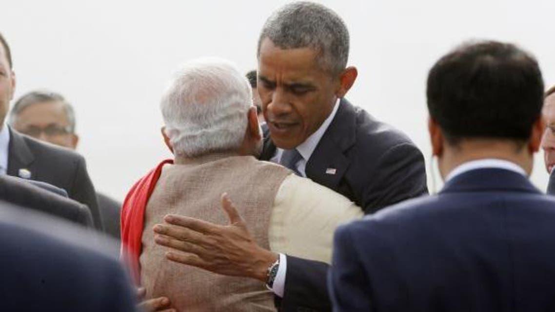 U.S. President Barack Obama hugs India's Prime Minister Narendra Modi as he arrives at Air Force Station Palam in New Delhi January 25, 2015. (Reuters)