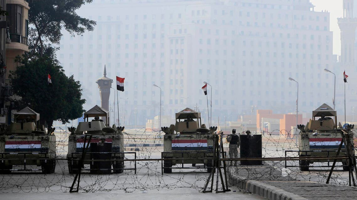 Armoured vehicles and barbed wire block an entrance to Tahrir Square during the 4th anniversary of the January 2011 uprising, in Cairo January 25, 2015. (Reuters)