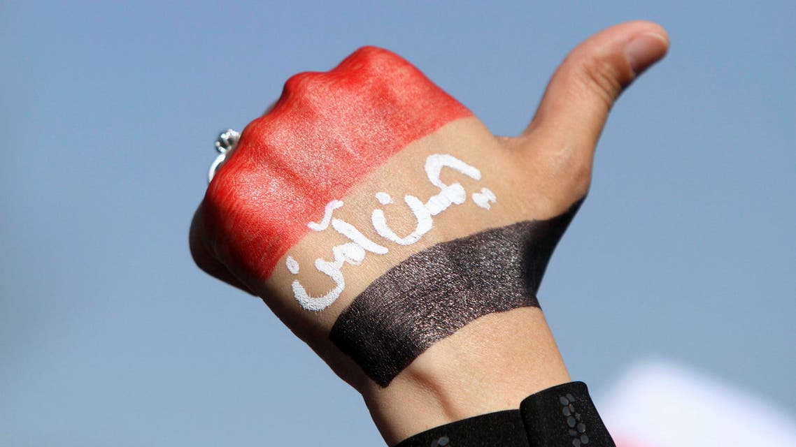 An anti-Houthi protester raises her fist painted with a Yemeni flag during a rally in Sanaa January 24, 2015. (Reuters)