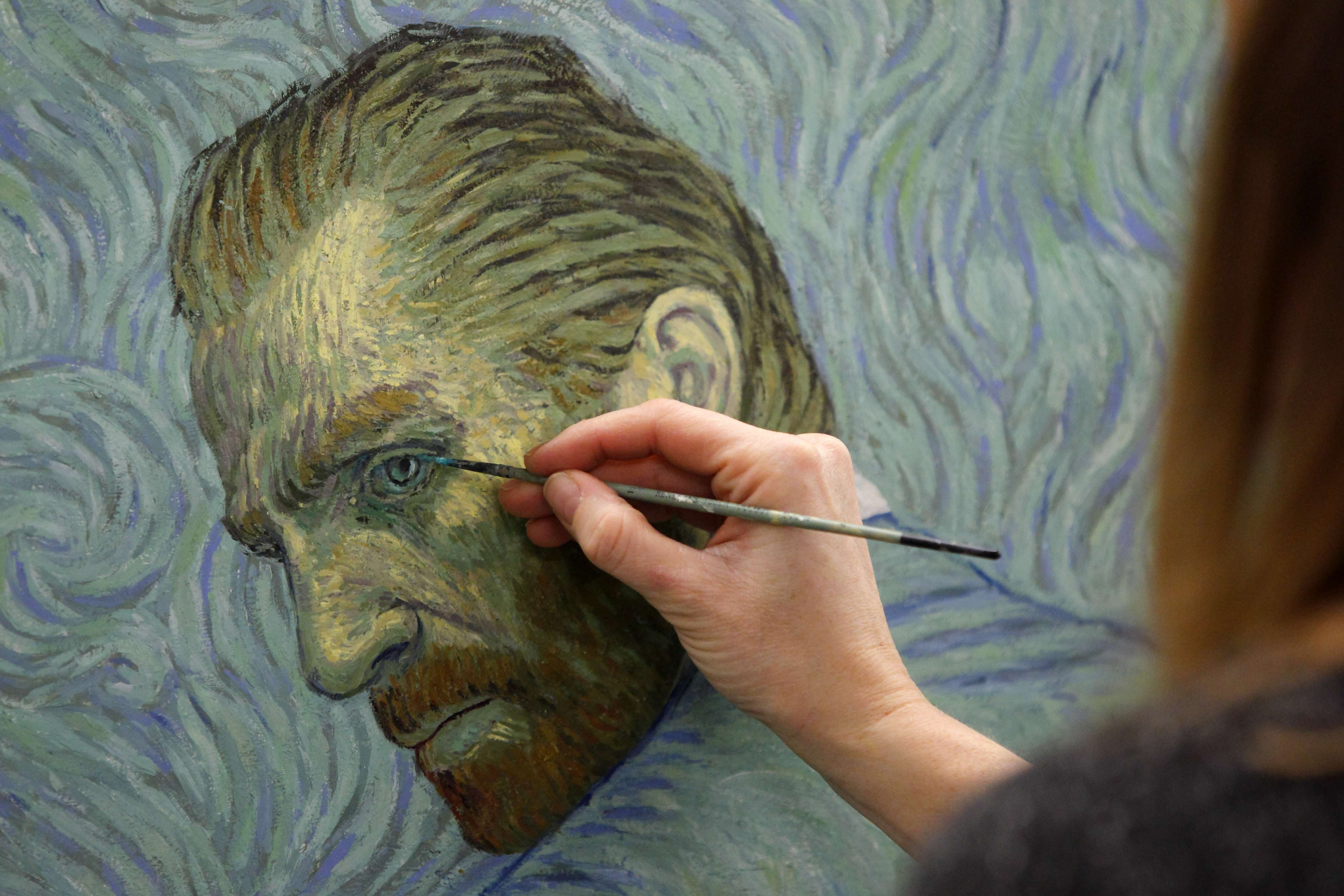 A painter recreates a Vincent van Gogh self-portrait at a film studio in the northern Polish city of Gdansk on December 5, 2014. (AFP)