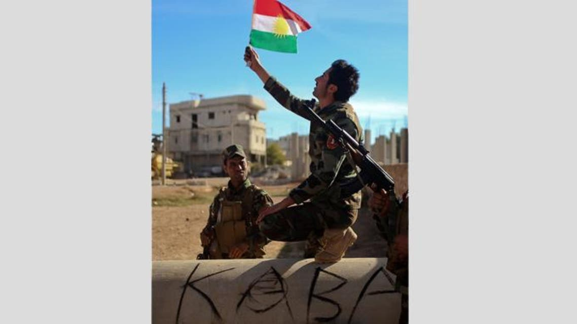 Kurdish Peshmerga fighters posing for a picture during a break in fighting against Islamic State (IS) group.