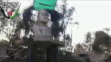 Opposition forces demolish Hafez al-Assad bust in Syria's Deraa