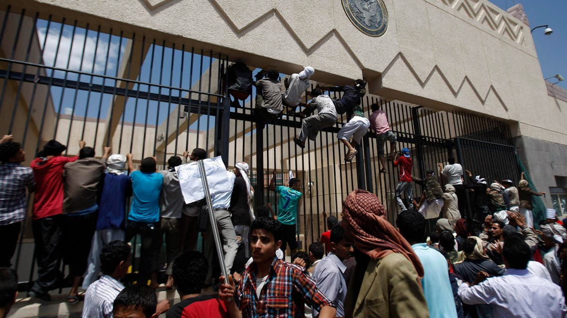 Yemeni protesters climb the gate of the U.S. Embassy during a protest about a film ridiculing Islam's Prophet Muhammad, in Sanaa, Yemen, Thursday, Sept. 13, 2012.  (AP)