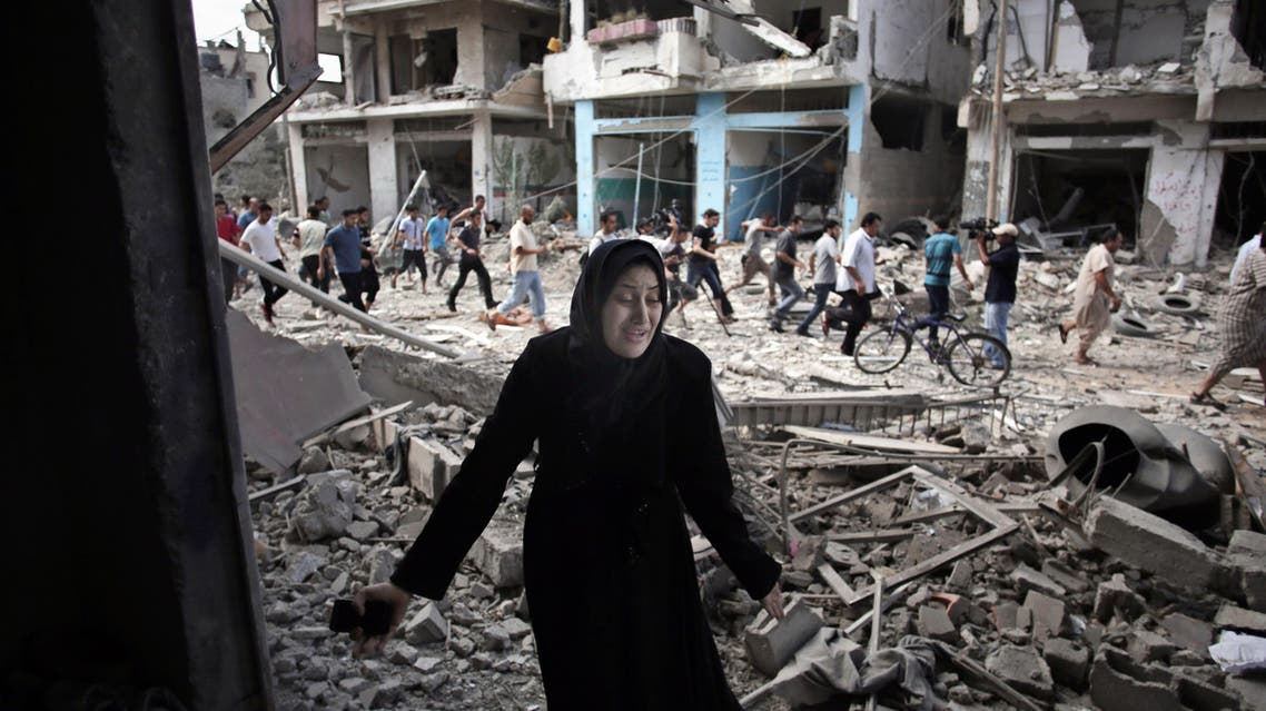 In this July 26, 2014 file photo, a Palestinian woman reacts after seeing her destroyed house during a 12-hour cease-fire in Gaza City's Shijaiyah neighborhood. AP