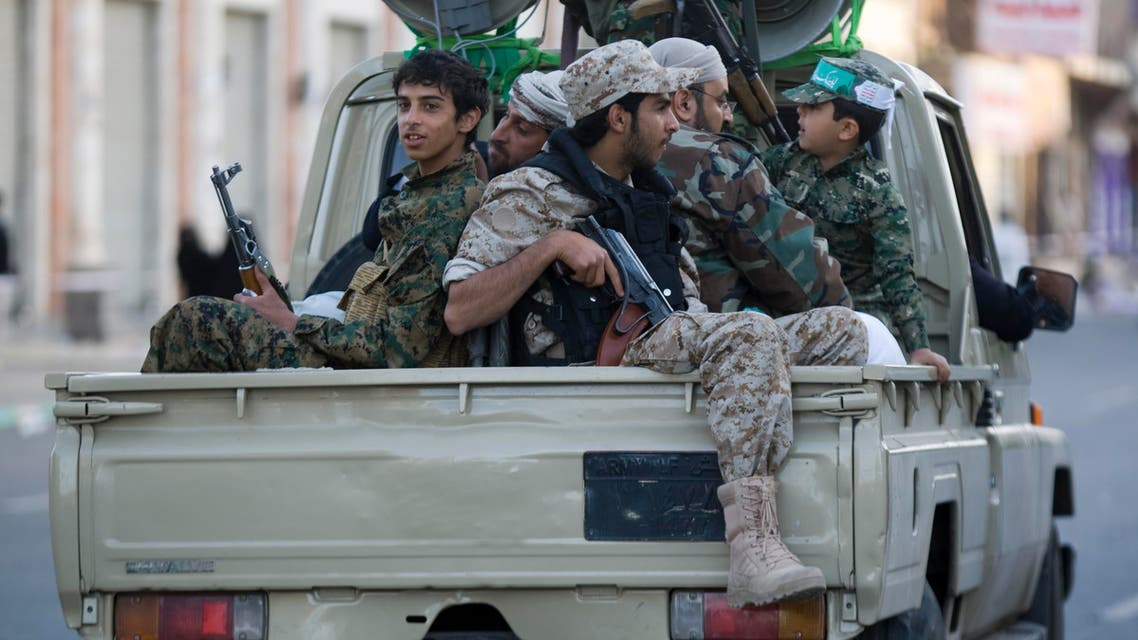 Houthi Shiite fighters wearing an army uniform ride on a pickup vehicle as they patrol a street during a demonstration to show support for their comrades in Sanaa, Yemen, Friday, Jan. 23, 2015. (AP)