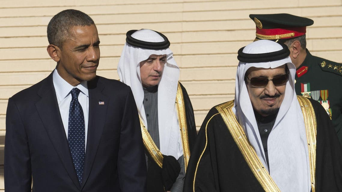US President Barack Obama stands alongside Saudi new King Salman (R) after arriving on Air Force One at King Khalid International Airport in the capital Riyadh on January 27, 2015. AFP